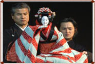 Bunraku puppet and puppeteers